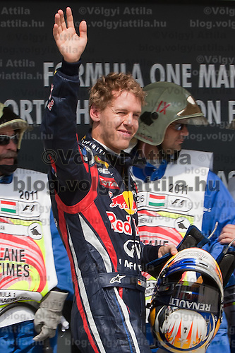 Red Bull Racing Formula One driver Sebastian Vettel of Germany celebrates his victory in the qualifyer of the Hungarian F1 Grand Prix in Mogyorod (about 20km north-east from Budapest), Hungary. Saturday, 30. July 2011. ATTILA VOLGYI