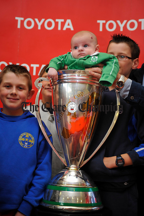 Three and a half month old Cillian Thornton tries the Trophy on for size during the visit of the Heineken Cup to Tom Hogan Motors Toyota centre, Ennis, on Monday evening. Photograph by John Kelly.