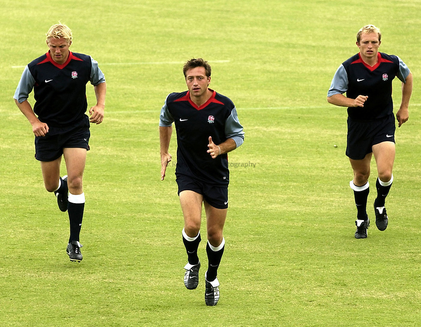 Photo: Richard Lane..England training at the Brisbane Grammer School, Brisbane. RWC 2003. 08/11/2003..Dan Luger, who comes onto the bench after Iain Balshaw pulls out trains alongside Lewis Moody (lt) and Matt Dawson (rt).