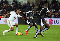 (L-R) Andre Ayew of Swansea against N'Golo Kante of Leicester City during the Barclays Premier League match between Swansea City and Leicester City at the Liberty Stadium, Swansea on December 05 2015