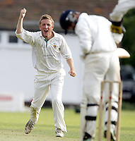 James Kidson of Shepherds Bush celebrates after capturing the wicket of Sikander Randhawa during the Middlesex County Cricket League Division Two game between Harrow St Mary's and Shepherds Bush at<br /> Harrow on Sat July 19, 2014
