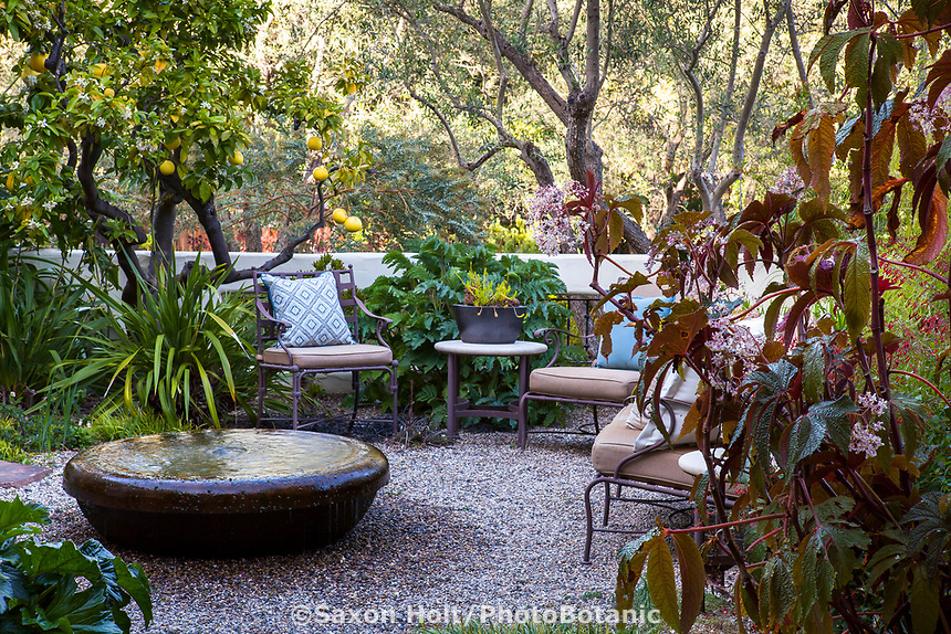 Water feature on gravel patio in California secret garden courtyard room; McAvoy Garden; Design - Ground Studio