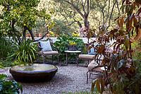 Water feature on gravel patio in California secret garden courtyard room; McAvoy Garden; Design - Ground Studio