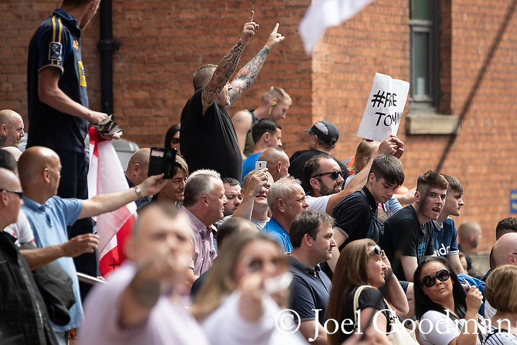 © Joel Goodman - 07973 332324 . 01/06/2018 . Leeds, UK. Supporters of EDL founder Tommy Robinson ( real name Stephen Yaxley-Lennon ) demonstrate outside Leeds Crown Court after Robinson was convicted of Contempt of Court . Robinson was already serving a suspended sentence for Contempt of Court over a similar incident , when he was convicted on Friday 25th May 2018 . Reporting restrictions , since lifted , initially prevented coverage of Robinson's arrest and incarceration . Photo credit : Joel Goodman