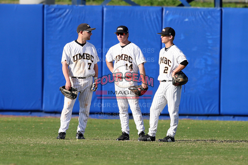 March 14, 2010:  Outfielders Bryan Russo (7), Casey Medairy (14), and Mike Lafferty (2) of UMBC in a game vs. Bucknell at Chain of Lakes Stadium in Winter Haven, FL.  Photo By Mike Janes/Four Seam Images
