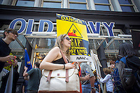 Hundreds of workers and supporters march through the streets of Soho on Saturday, June 29, 2013 stopping off at various clothing retailers including the Gap's Old Navy, protesting the companies' refusal to the Bangladesh Safety Accord guaranteeing better safety conditions in Bangladeshi factories. In April a collapse of an enormous garment factory killed over 1000 workers. (© Richard B. Levine)
