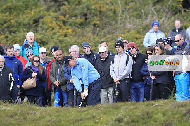 Ernie ELS (RSA) plays his 3rd shot from the rough on the 1st hole during Friday's Round 2 of the 2015 Dubai Duty Free Irish Open, Royal County Down Golf Club, Newcastle Co Down, Northern Ireland 5/29/2015<br />  Picture Eoin Clarke, www.golffile.ie