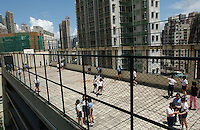 School children play at roof top playground in the city of Hong Kong