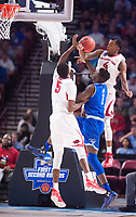 NWA Democrat-Gazette/J.T. WAMPLER Arkansas' Daryl Macon (4) and Arlando Cook break up a layup by Seton Hall's Michael Nzei  Friday Mar. 17, 2017 during the first round of the NCAA Tournament at the Bon Secours Wellness Arena in Greenville, South Carolina. Arkansas won 77-71 and will advance to the second round, playing Sunday at the same location.