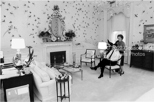Washington, DC - November 18, 1981 -- United States President Ronald Reagan and first lady Nancy Reagan spend a relaxed moment together in the sitting area of their bedroom at the White House in Washington, DC on November 18, 1981..Credit: White House via CNP