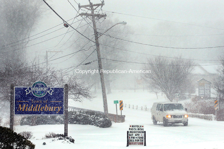 MIDDLEBURY CT. 14 March 2017-031417SV06-A car tries to make its way down Rt. 64 during whiteout conditions in Middlebury Tuesday..<br /> Steven Valenti Republican-American