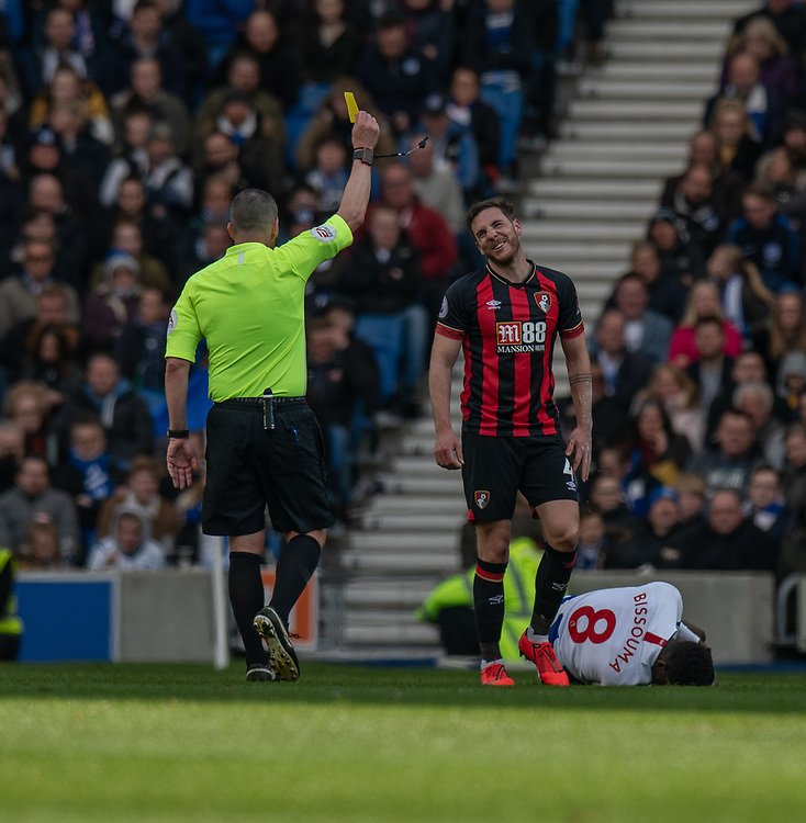 Bournemouth's Dan Gosling is shown a yellow card by referee Kevin Friend for a for challenge on Brighton & Hove Albion's Yves Bissouma <br /> <br /> Photographer David Horton/CameraSport<br /> <br /> The Premier League - Brighton and Hove Albion v Bournemouth - Saturday 13th April 2019 - The Amex Stadium - Brighton<br /> <br /> World Copyright © 2019 CameraSport. All rights reserved. 43 Linden Ave. Countesthorpe. Leicester. England. LE8 5PG - Tel: +44 (0) 116 277 4147 - admin@camerasport.com - www.camerasport.com
