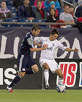 Vancouver Whitecaps FC midfielder Shea Salinas (22) attempts to control the ball as New England Revolution defender Chris Tierney (8) pressures. In a Major League Soccer (MLS) match, the New England Revolution defeated the Vancouver Whitecaps FC, 1-0, at Gillette Stadium on May14, 2011.