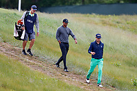From left to right Tiger Woods (USA) and Justin Thomas (USA) walk the 5th hole during the second round of the 118th U.S. Open Championship at Shinnecock Hills Golf Club in Southampton, NY, USA. 15th June 2018.<br /> Picture: Golffile | Brian Spurlock<br /> <br /> <br /> All photo usage must carry mandatory copyright credit (&copy; Golffile | Brian Spurlock)