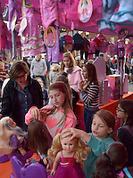 NWA Democrat-Gazette/BEN GOFF @NWABENGOFF<br /> Ava Parker (left), 10, and sister Lyla Parker, 8, of Bentonville style My Life As 18-inch dolls on Friday Nov. 6, 2015 during Downtown Bentonville, Inc.'s First Friday: Toyland on the Bentonville Square. Walmart toy vendors displayed a variety of their new offerings at the event ahead of the holiday shopping season.