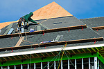 CHESHIRE , CT-011419JS04- A worker lays roof shingles on Monday as construction continues on the new 50,000 square foot Hartford Healthcare facility on South Main Street in Cheshire. The facility will be a medical facility offering primary care by physicians from Hartford HealthCare.<br /> Jim Shannon Republican American