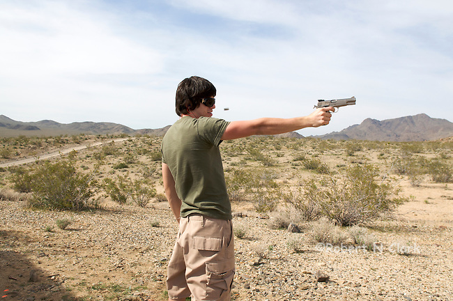 Youth firing Browning 9mm Hi Power semi-auto pistol