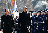 United States President Barack Obama (R) walks with French President Francois Hollande for a military review during a welcoming ceremony on the South Lawn at the White House on February 11, 2014 in Washington, DC. Hollande who arrived yesterday for a three day state visit, visited Thomas Jefferson's Monticello estate and will be the guest of honor for a state dinner tonight.<br /> Credit: Chip Somodevilla / Pool via CNP