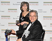 Washington, DC - December 5, 2009 -- Itzhak Perlman and his wife, Toby Friedlander, arrive for the formal Artist's Dinner at the United States Department of State in Washington, D.C. on Saturday, December 5, 2009..Credit: Ron Sachs / CNP.(RESTRICTION: NO New York or New Jersey Newspapers or newspapers within a 75 mile radius of New York City)