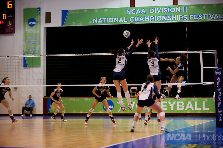 04 DEC 2010:  Melissa Vanderhall (24) of Tampa spikes the ball past Cassie Haaag (2) and Kayla Koenecke (3) of Concordia-St. Paul  during the Division II Women's Volleyball Championship held at Knights Hall on the Bellarmine campus in Louisville, KY.  Concordia St. Paul won over Tampa 3-1. Josh Duplechian/NCAA Photos