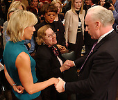 hington, D.C. - March 24, 2004 -- Family members crowd around Richard A. Clarke at the conclusion of his testimony before the National Commission on Terrorist Attacks Upon the United States hearing  in Washington, DC on March 24, 2004. From right to left: Richard Clarke, Carol Ashley, Beverly Eckert.<br /> Credit: Ron Sachs / CNP<br /> [RESTRICTION: No New York Metro or other Newspapers within a 75 mile radius of New York City]