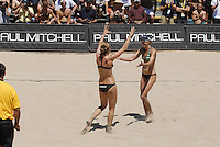 Huntington Beach, CA - 5/6/07:  Elaine Youngs, right, and Nicole Branagh congratulate each other after scoring during Branagh / Youngs' 21-13, 21-13 loss to May-Treanor / Walsh in the championship match of the AVP Cuervo Gold Crown Huntington Beach Open of the 2007 AVP Crocs Tour..Photo by Carlos Delgado