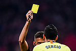 Sergio Busquets of FC Barcelona (R) gets a yellow card from FIFA Referee Jesus Gil Manzano (L) during the La Liga 2018-19 match between Atletico Madrid and FC Barcelona at Wanda Metropolitano on November 24 2018 in Madrid, Spain. Photo by Diego Souto / Power Sport Images