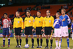 27 October 2007: The game's officials (from left), assistant referee Rob Fereday, referee Alex Prus, fourth official Jorge Gonzalez, assistant referee Greg Barkey, stand between Chivas USA's Claudio Suarez (MEX) (2) and Kansas City's Jimmy Conrad (12). The Kansas City Wizards defeated Club Deportivo Chivas USA 1-0 in the first leg of their Major League Soccer Western Conference Semifinal playoff series at Arrowhead Stadium in Kansas City, Missouri.