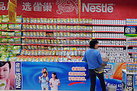 Nestle products being sold in a supermarket in Guangzhou, China. The financial crisis won't have too much impact on Chinese consuming market. According to a survey by Nielsen of 50 countries and regions, only 35 percent of Chinese people believed the domestic economy was in a contraction. The figure was the lowest among the 50 world markets..27 Jun 2009