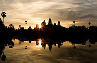 The five lotus-shaped towers of Angkor Wat temple stand at sunrise, in Ankgor, Cambodia, on October 8, 2009. Angkor Wat (or Angkor Vat), is a temple complex at Angkor built for the king Suryavarman II in the early 12th century as his state temple and capital city. Angkor used to be the seat of the Khmer empire, which flourished from approximately the ninth century to the thirteenth century. The ruins of Angkor temples are a UNESCO World Heritage Site. Photo by Lucas Schifres/Pictobank