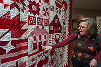 "NWA Democrat-Gazette/ANTHONY REYES @NWATONYR<br /> Barbara Hamernik talks Monday, April 3, 2017 about her quilt ""Farm Girl Goes Red and White"" at the Shiloh Museum in Springdale. The quilt won Judge's Choice and First Place Pieced, Twin/Full Size Category in the Tomorrow's Heirlooms XVI quilt show."