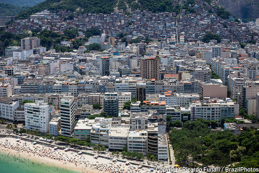 Ipanema district at center, an upper-middle-class neighborhood in Rio de Janeiro, Cantagalo favela in background and Arpoador beach in foreground. Cooexistence of rich and poor people in the same neighborhood.