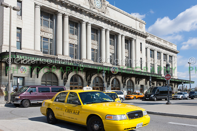 Taxis and other vehicles wait for passengers outside Pennsylvania Station in Baltimore, Maryland.