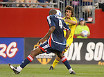16 June 2007: Columbus's Guillermo Barros Schelotto (ARG) (behind) sends a cross past New England's Avery John (TRI) (4) that resulted in the game's final goal.  The New England Revolution tied the Columbus Crew 3-3 at Gillette Stadium in Foxboro, Massachusetts in a regular season Major League Soccer 2007 game.
