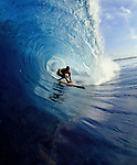 20 September 2004, Lombok, Indonesia --- A surfer rides a wave at reef break in Lombok, Indonesia.  Photo by Victor Fraile --- Image by © Victor Fraile