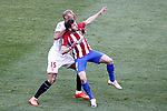 Atletico de Madrid's Saul Niguez (r) and Sevilla FC's Steven N'Zonzi during La Liga match. March 19,2017. (ALTERPHOTOS/Acero)