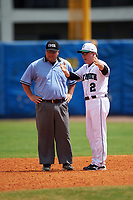 Dartmouth Big Green head coach Bob Whalen (2) argues a call with the field umpire during a game against the Lehigh Mountain Hawks on March 20, 2016 at Chain of Lakes Stadium in Winter Haven, Florida.  Dartmouth defeated Lehigh 5-4.  (Mike Janes/Four Seam Images)