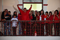 Venezuelan President  Hugo Chavez  celebrates his victory in the presidential election from the balcony of Miraflores presidential Palace in Caracas. Chavez , after 14 years in power, defeated opposition leader Henrique Capriles Radonski by more than a million votes and become president for fourth term in a raw.