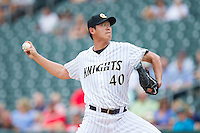 Charlotte Knights starting pitcher Chien-Ming Wang (40) in action against the Pawtucket Red Sox at BB&T Ballpark on August 8, 2014 in Charlotte, North Carolina.  The Red Sox defeated the Knights  11-8.  (Brian Westerholt/Four Seam Images)