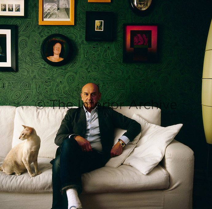 A portrait of designer Antonio Ponte seen in his apartment.