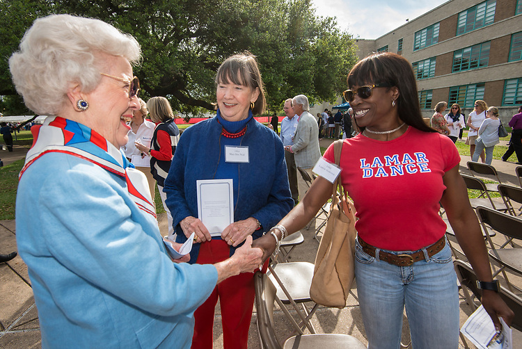 Lauren Anderson '82 talks with other alumni during a groundbreaking ceremony at Lamar High School, March 30, 2017.