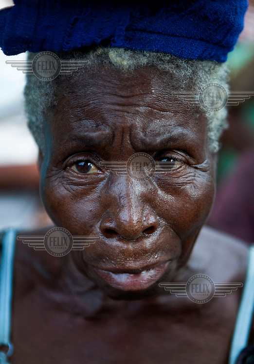 A woman listens to the last words of Ogoni leader Ken Saro-Wiwa, spoken during a political meeting of Ogoni activists. Oil pollution in the Delta is causing tremendous problems for the local community.