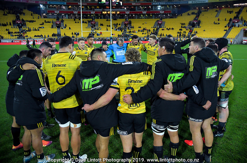 The Hurricanes huddle after winning the Super Rugby match against the Chiefs at Westpac Stadium in Wellington, New Zealand on Friday, 27 April 2019. Photo: Dave Lintott / lintottphoto.co.nz
