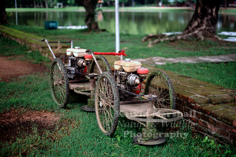 Old Lawnmower in the grounds of the Sukhothai Historical Park - Thailand.