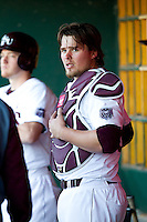 Luke Voit (30) of the Missouri State Bears puts on his catchers gear in the dugout during a game against the Southern Illinois University- Edwardsville Cougars at Hammons Field on March 9, 2012 in Springfield, Missouri. (David Welker / Four Seam Images)
