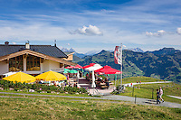 Austria, Tyrol, above Kitzbuehel: restaurant 'Hahnenkamm Stueberl', at background Loferer Steinberge mountains (left) and Leoganger Steinberge mountains (right) | Oesterreich, Tirol, oberhalb Kitzbuehel: Restaurant Hahnenkamm Stueberl, im Hintergrund die Loferer Steinberge (links) und die Leoganger Steinberge (rechts)