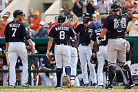 Detroit Tigers Nicholas Castellanos (9) high fives Mikie Mahtook (8) after scoring on a home run by left fielder Christin Stewart (background) during a Grapefruit League Spring Training game against the New York Yankees on February 27, 2019 at Publix Field at Joker Marchant Stadium in Lakeland, Florida.  Yankees defeated the Tigers 10-4 as the game was called after the sixth inning due to rain.  Jordy Mercer (7) and Gordon Beckham (29) are also shown.  (Mike Janes/Four Seam Images)