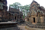 Angkorian temple Banteay Srei (late 10th century) 967.<br /> View from the corner of the southern tower sanctuary towards the Mandapa in centre and southern library on right.<br /> Three sanctuary towers.The central sanctuary and the southern sanctuary were dedicated to Shiva and the northern sanctuary was dedicated to Vishnu.<br /> Banteay Srei temple is situated 20km north of Angkor, built during the reign of Rajendravarman by Yajnavaraha, one of his counsellors. In antiquity Isvarapura was a small city that grew up around the temple. Banteay Srei was dedicated to the worship of Shiva, the foundation stele describes the consecration of the linga Tribhuvanamahesvara (Lord of the three worlds) in 967.