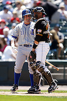 May 25, 2009:  Jon Weber (11) of the Durham Bulls, International League Triple-A affiliate of the Tampa Bay Rays, jokes with Jose Morales before an at bat during a game at Frontier Field in Rochester, NY.  Photo by:  Mike Janes/Four Seam Images