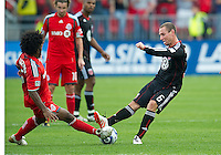 August 21 2010   D.C. United midfielder Kurt Morsink #6 and Toronto FC midfielder Julian de Guzman #6 in action during a game between DC United and Toronto FC at BMO Field in Toronto..DC United won 1-0.